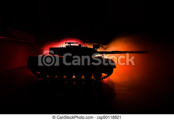 War Concept  Military silhouettes fighting scene on war fog sky background,  World War German Tanks Silhouettes Below Cloudy Skyline At night  Attack