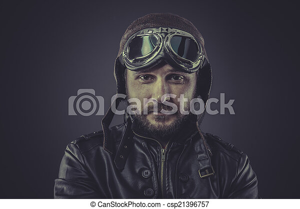 war pilot dressed in vintage style leather cap and goggles - csp21396757