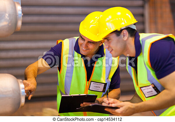 warehouse co-workers inspecting machinery - csp14534112