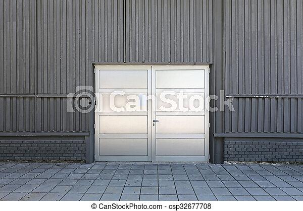 Warehouse Door - csp32677708 & Warehouse door. Silver door at warehouse storage building stock ...