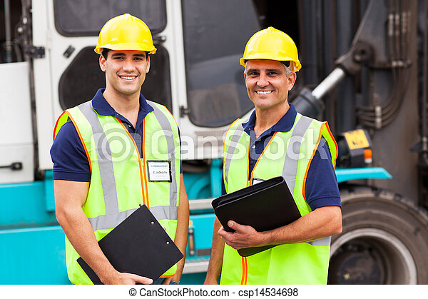 warehouse worker standing in front of container forklift - csp14534698