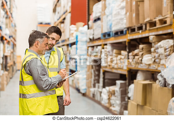 Warehouse workers talking together at work - csp24622061