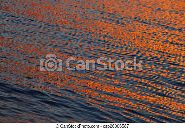 Warm color shining sunset water surface - csp26006587
