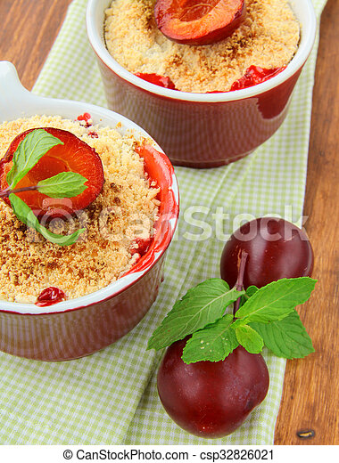 warm crumble dessert with plums - csp32826021