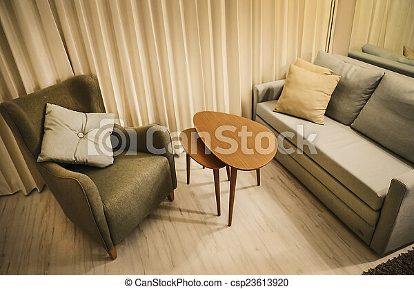 Warm living room with couch, arm chair and coffee modular table set - csp23613920