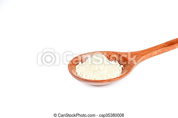 Wasabi powder in wooden spoon on white background. - csp35380008