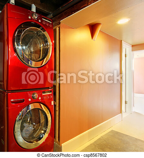 stock photo washer and dryer in red in the basement