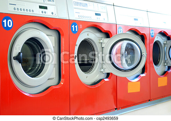 washing machines in a laundromat in a row - csp2493659