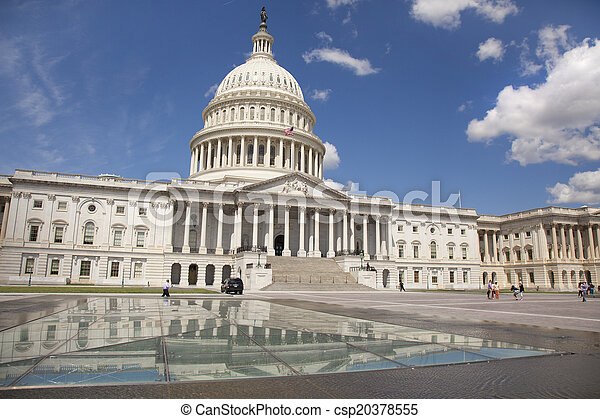 WASHINGTON D.C. - MAY 23 2014: The United States Capitol is the meeting place of the United States Congress, the legislature of the U.S. federal government. Located in Washington, D.C., it sits atop C - csp20378555