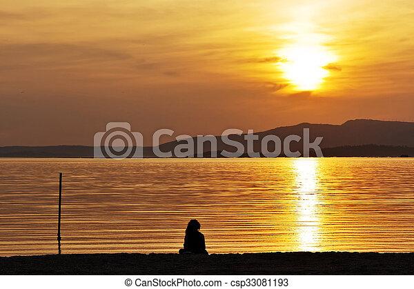 Watching the sunset - csp33081193