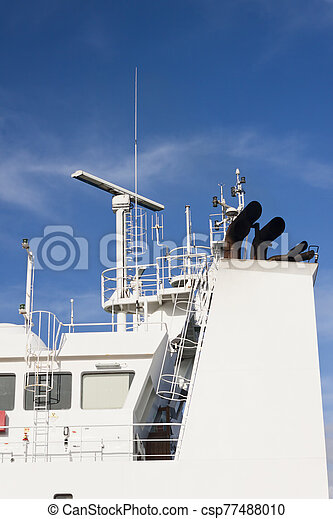 Watchtower, antennas, radar and other communication and navigation equipment on the command bridge of a ship. - csp77488010