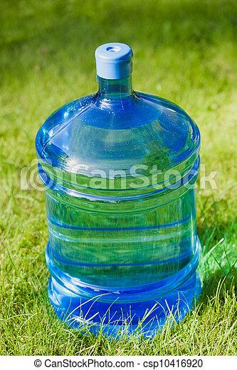 water big bottle on green grass background - csp10416920