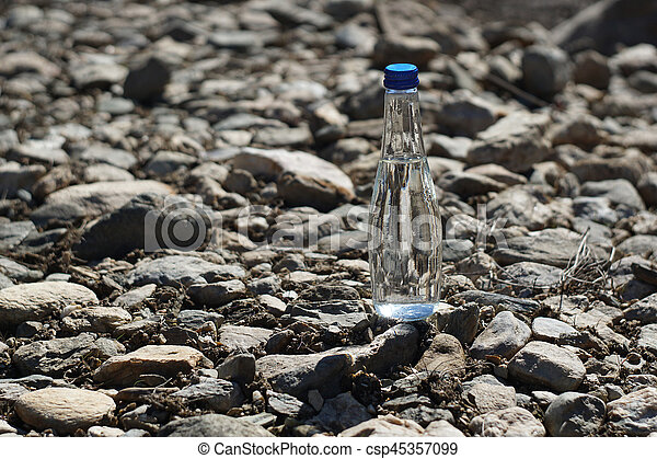 Water bottle on a stone background - csp45357099