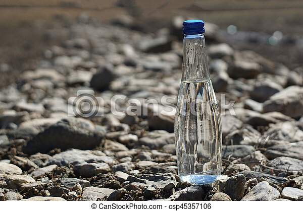 Water bottle on a stone background - csp45357106
