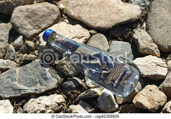 Water bottle on a stone background - csp45356935