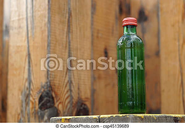 Water bottle on a wooden background - csp45139689