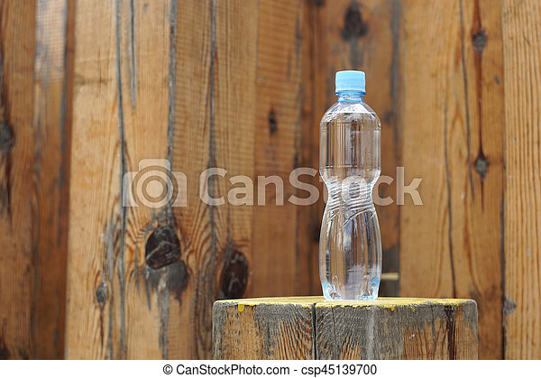 Water bottle on a wooden background - csp45139700