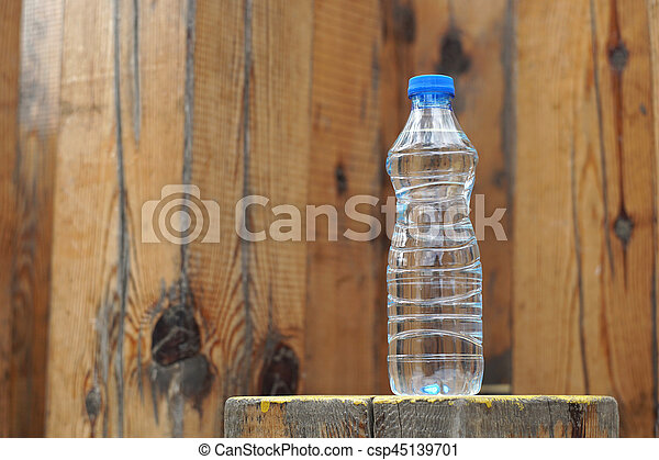 Water bottle on a wooden background - csp45139701