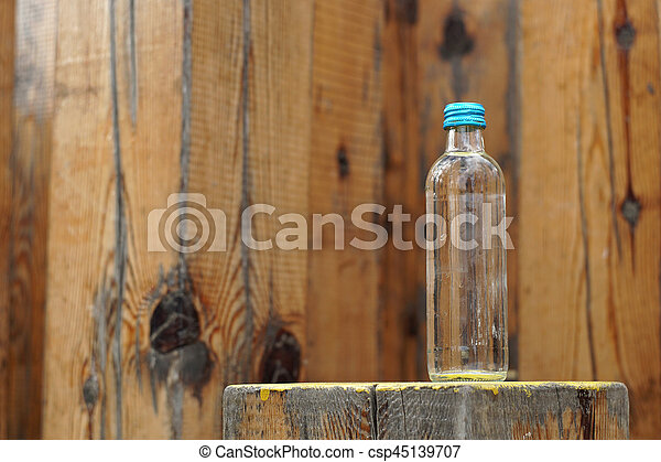 Water bottle on a wooden background - csp45139707