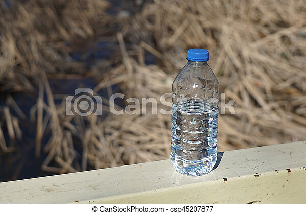 Water bottles on a background of blurred canes - csp45207877
