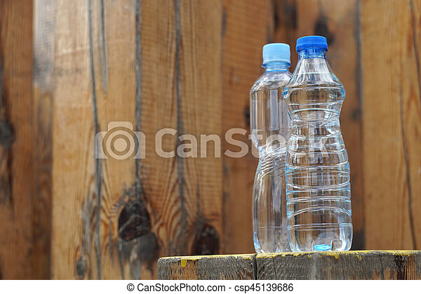 Water bottles on a wooden background - csp45139686