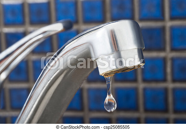 Water drop dripping from tap. Close-up of leakage tap with... stock ...