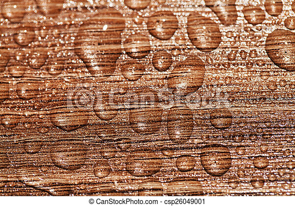 water drop on a wooden background - csp26049001
