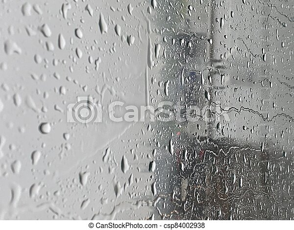 Water droplets on the glass with a background - csp84002938
