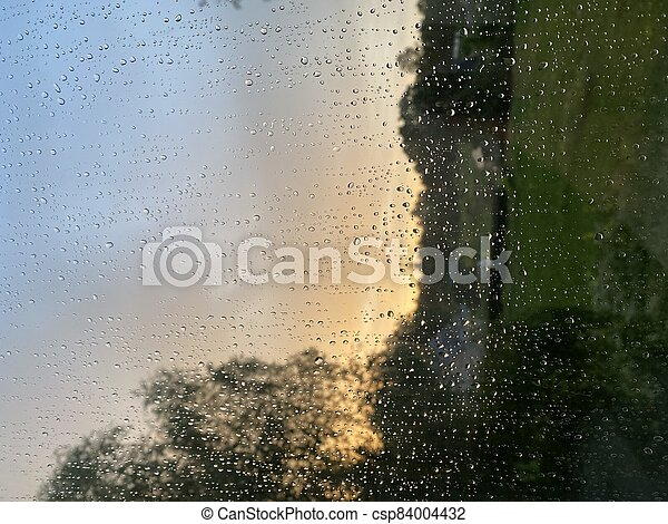 Water droplets on the glass with a background - csp84004432