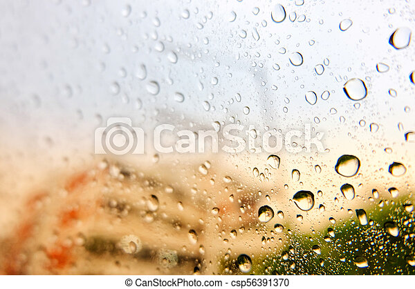 Water drops on car glass in a rainy day. - csp56391370