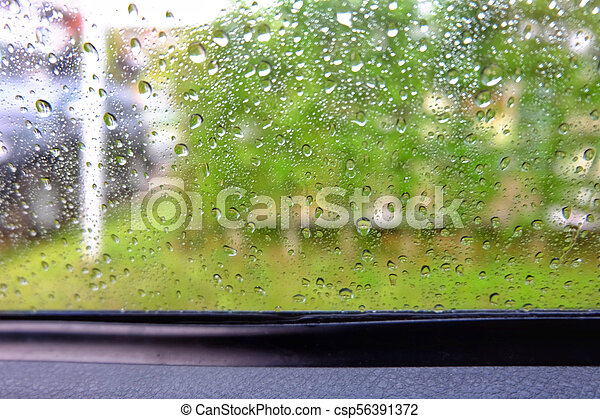Water drops on car glass in a rainy day. - csp56391372