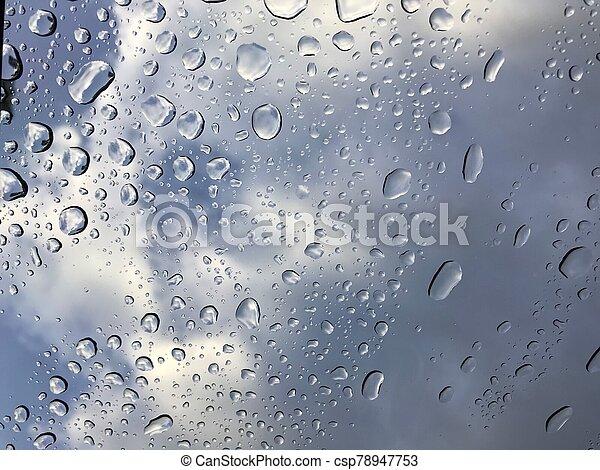 water drops on car window shield after rain stops - csp78947753