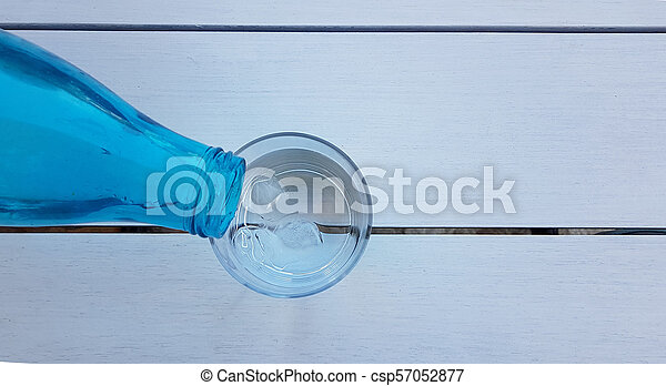 water glass bottle on the table - csp57052877