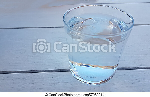 water glass bottle on the table - csp57053014