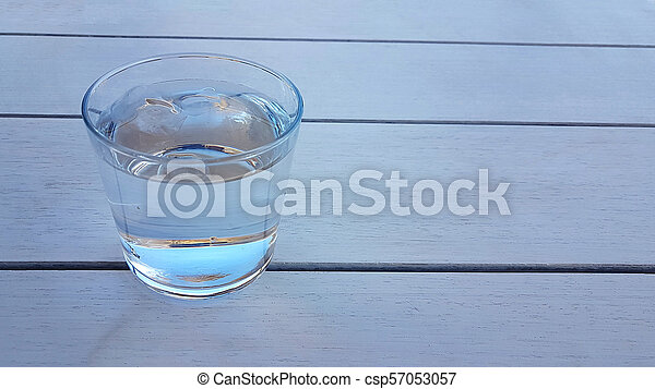 water glass bottle on the table - csp57053057