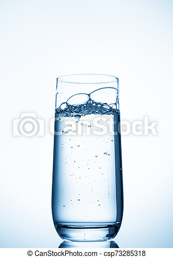 water glass on blue background - csp73285318