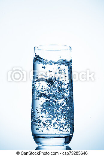 water glass on blue background - csp73285646