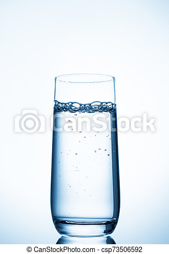 water glass on blue background - csp73506592