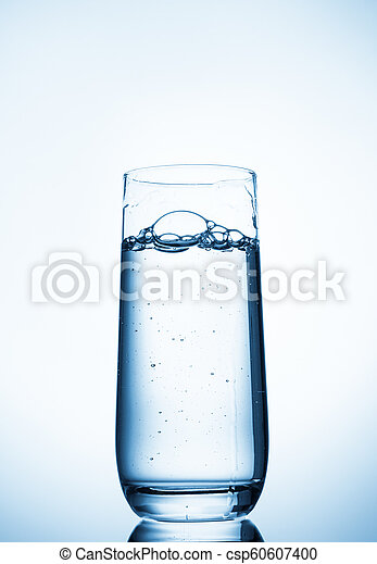 water glass on blue background - csp60607400