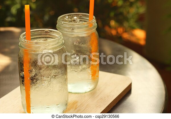 Water in a glass on a tray of wooden. - csp29130566