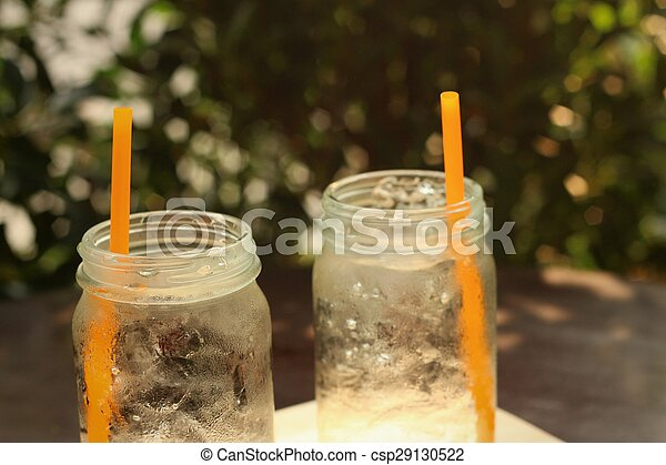 Water in a glass on a tray of wooden. - csp29130522