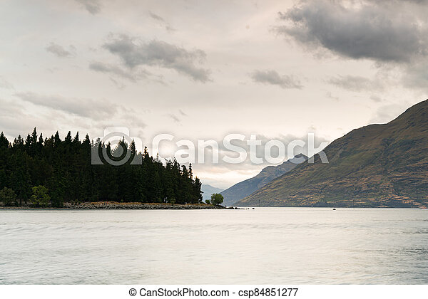 Water lake with mountain and cloudy sky - csp84851277