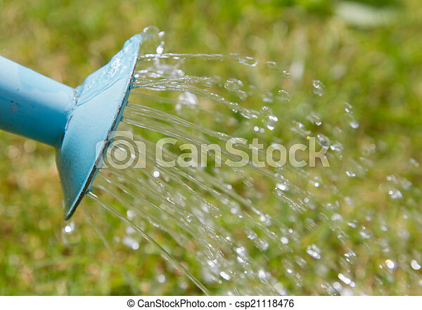 Water pouring from a blue watering can - csp21118476