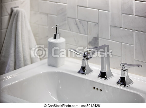 Cropped view of water sink in bathroom