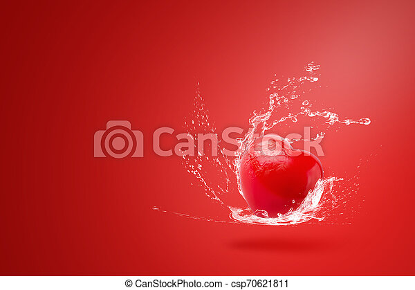 Water splashing on Red ball foam with shape heart on red background - csp70621811