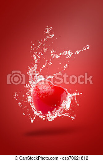 Water splashing on Red ball foam with shape heart on red background - csp70621812