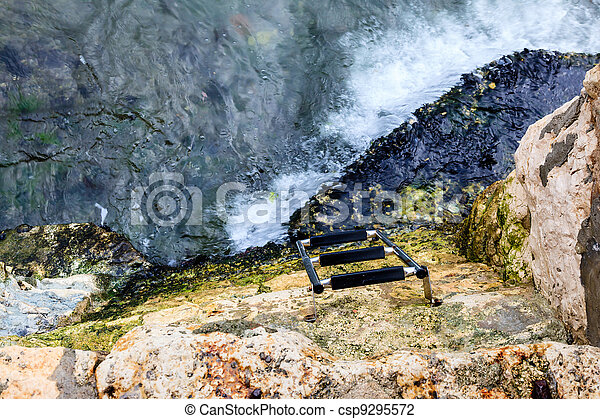 Water Stairs on the Rocky Beach in Rovinj, Croatia - csp9295572