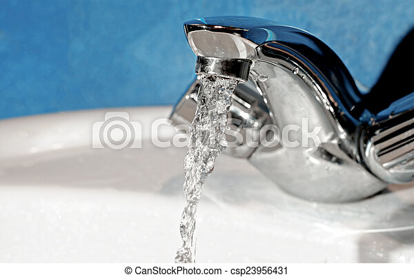 Water tap with flowing water. Selective focus, shallow depth of field - csp23956431