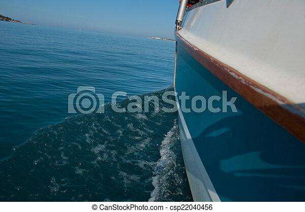 Water wake behind yacht - csp22040456