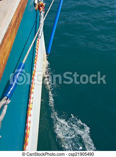 Water wake behind yacht - csp21905490